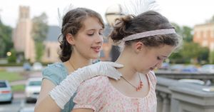 Photograph of two young women preparing for a Summer Program event