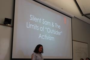 Photograph of ENGL 105i student delivering conference presentation
