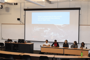 Photograph of ENGL 105i students presenting at a conference