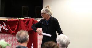 Photograph of Marianne Gingher Preparing for Puppet Show