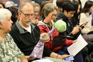 Photograph of Audience Members and Puppet